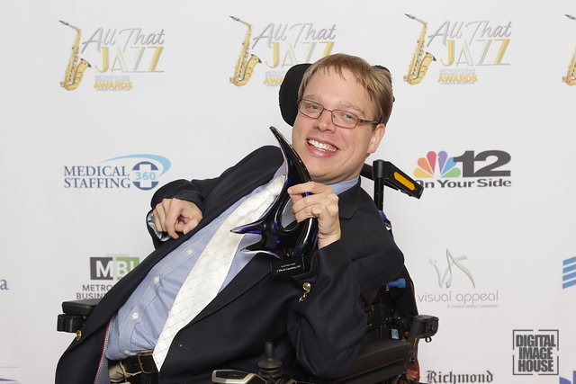 PHOTO: Matthew holding the Metropolitan Business League's Social Vision Award that he won.