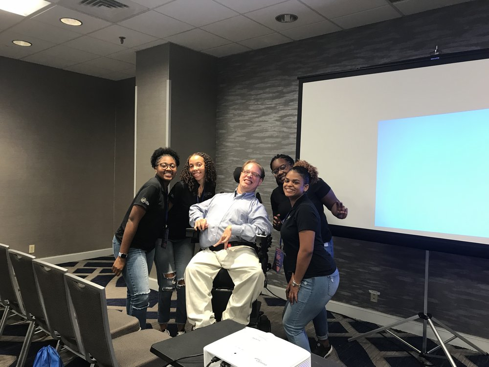 PHOTO: Matthew smiling with four enthusiastic students from VCU's Student activities board. This was after his presentation at the NACA South conference in Atlanta, Georgia.