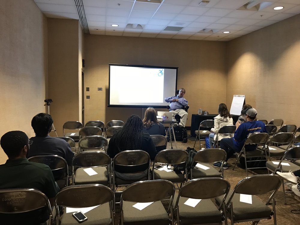 PHOTO: Matthew, In the front of a small room, presenting his second Ed session In Buffalo, New York. This one was about getting out of your comfort zone.