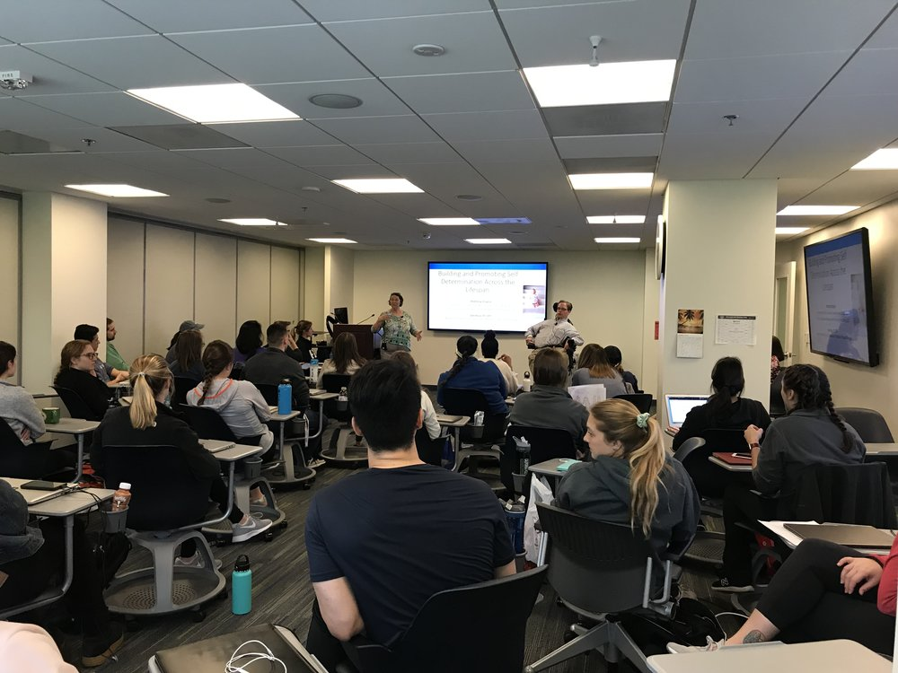 PHOTO: Matthew speaking to OT and PT Students at George Washington University about the importance of developing self-determination within their patients.