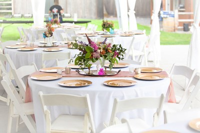 Blush, milk glass, and gold centerpieces