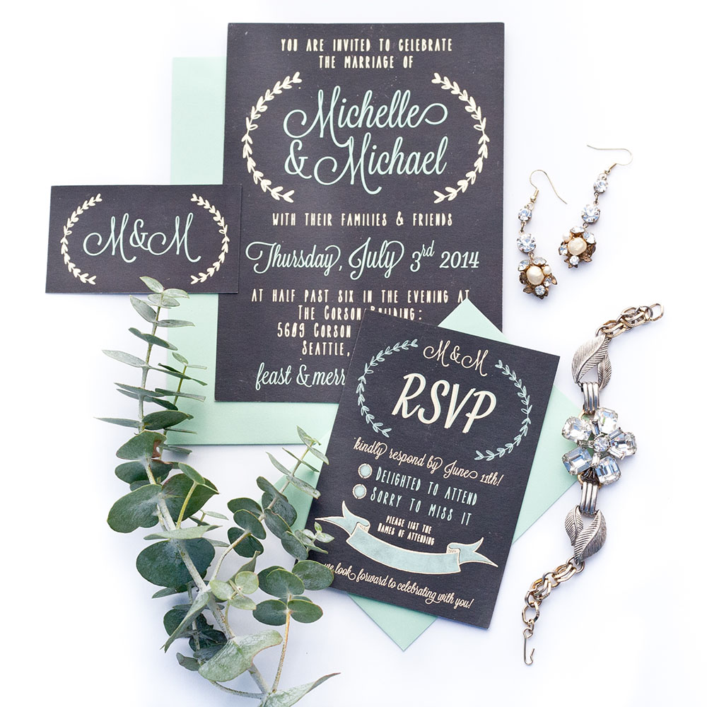 Keeping with a sweet mint and metallic gold foiled theme for Mike & Michelle's wedding, while capturing the farm house style of their venue with laurels and a slate background.