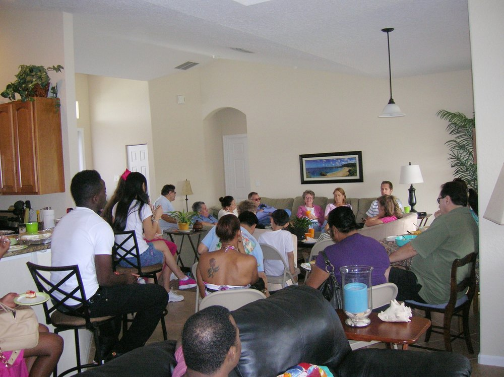 Gathering - On November 29, 2012, Pastor J.C. held the very first weekly bible study in his home. Word of mouth, door to door evangelism, and community engagement were some of the ways the Lord brought people to Christ the King Church.