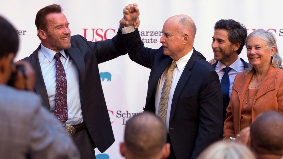 Former Gov. Arnold Schwarzenegger, left, a Republican, and Democratic Gov. Jerry Brown