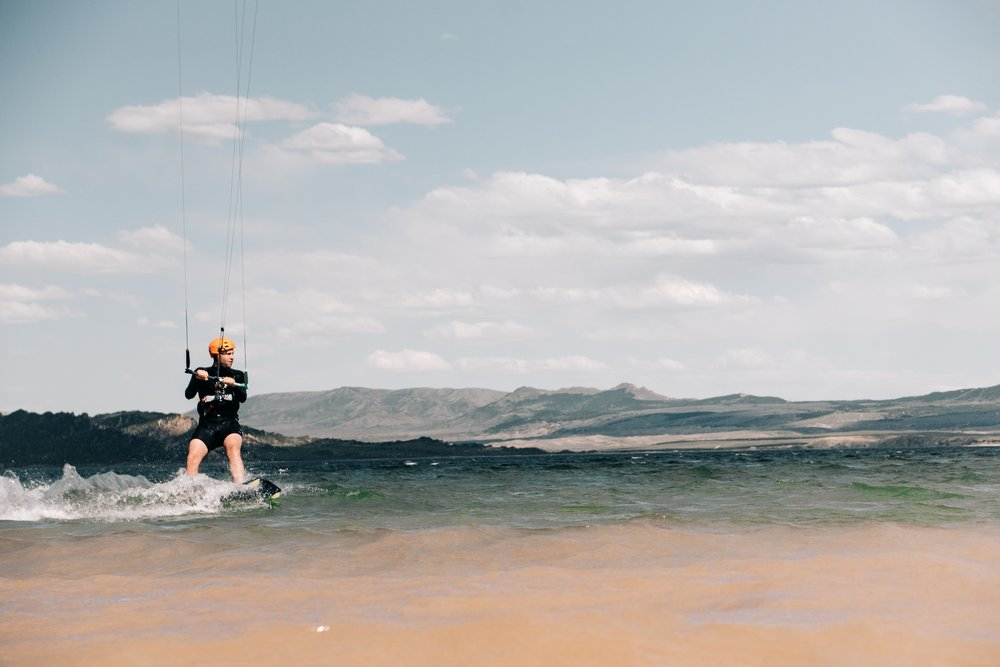 More proof that you need to add kiteboarding to your quiver of gear. Anywhere with wind and water is a potential place to kiteboard! Flaming Gorge was no exception. | Sarah Dalton