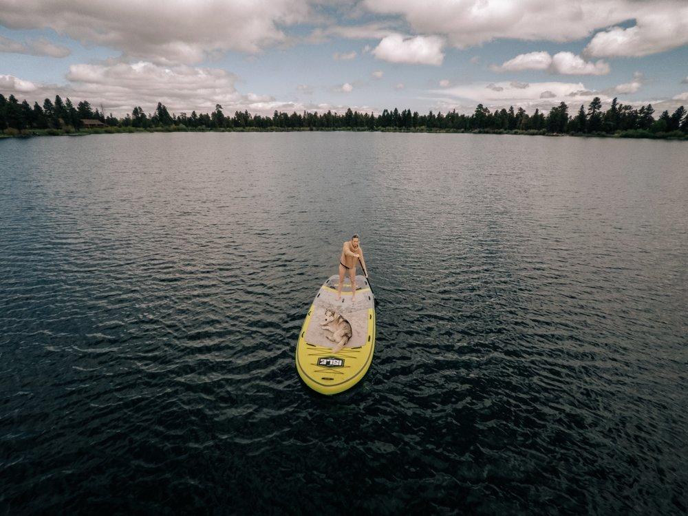 Sarah Dalton and Ophir Dog having some paddle boarding for breakfast.| Edward Arthur Dalton