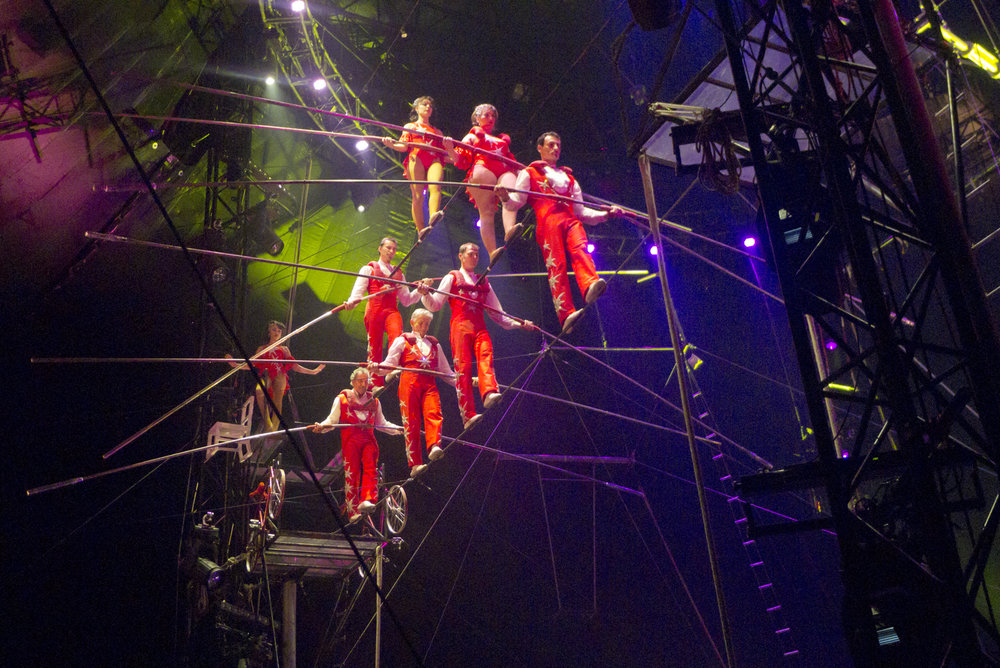 Sacha and the Flying Wallendas - In 1998, Pavlata joined the Flying Wallenda family to help them create their famous seven-person pyramid on the high wire.  Sacha has worked with the Wallendas on the high wire around the world ever since.  Sacha was part of the Wallenda Troupe when they won the Silver Clown at the prestigious Monte Carlo Festival du Cirque in 2003.  He is third man on the base in the photo at left.