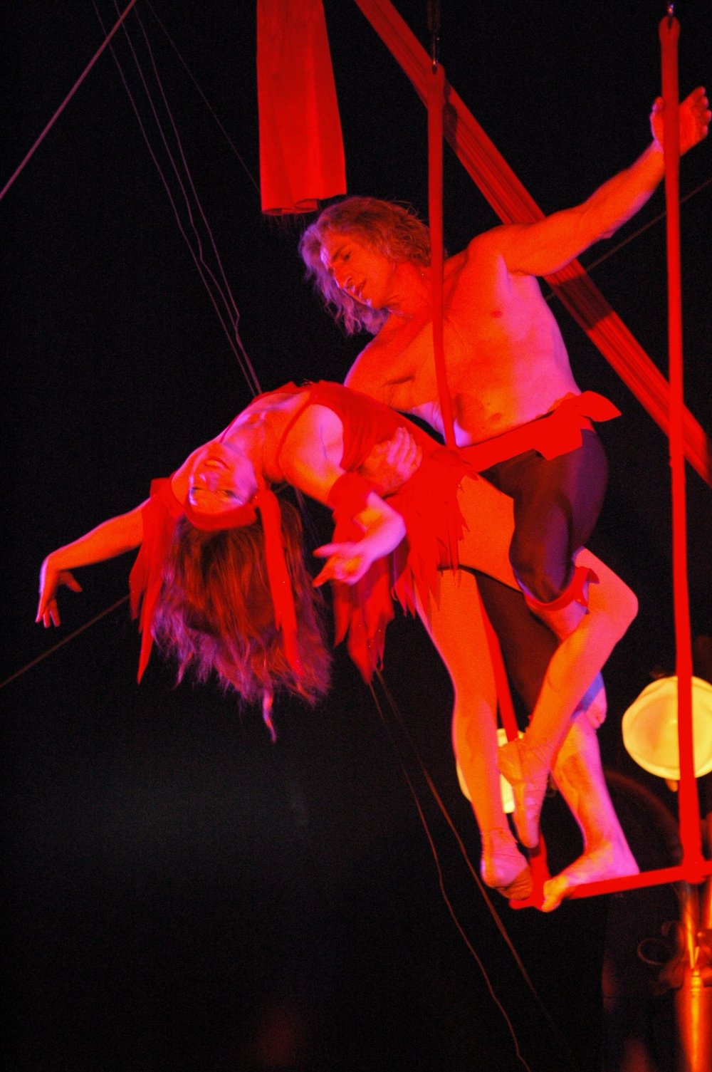 Melinda & Sacha - Melinda's husbaND sacha Pavlata first trained her as an aerialist in 2004 for circus flora.  (photo at left by Harald boerstler of Circus Flora).  they went on to perform this artistic trapeze duet around the world: in singapore, with cirque passion, at the baltimore museum of art, the wallenda family circus in taiwan, amazing grace circus and for redbull's art of the can exhibit in boston.  Melinda loved combining the newfound power of her aerial circus muscles with her dance training and went on to create elegant performances on aerial hoop (lyra), aerial fabric (silks), aerial sling and corde lisse.
