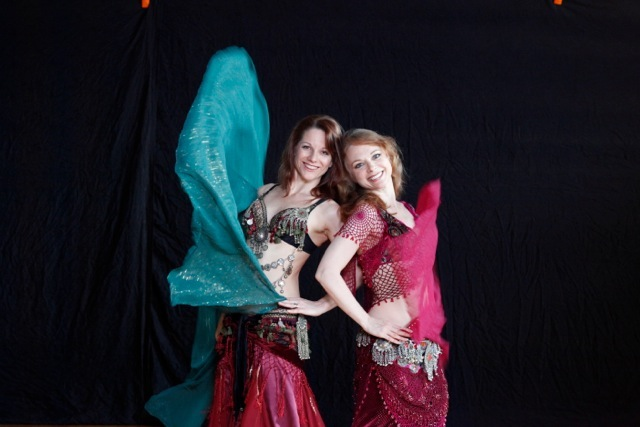 Daughters of Rhea - Melinda melina and her sister piper co-founded the daughters of rhea dance company to honor their mother's lifelong career in belly dancE and to continue her legacy in their own ways. They love performing together when they can. This photo by Cheryl Clegg is featured on the cover of the fred elias ensemble cd