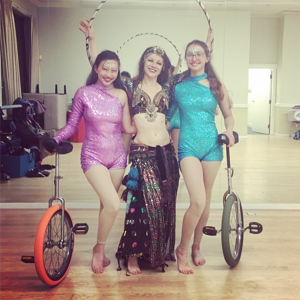 Moody Street Circus Unicyclists Millie and Audrey with Director Melinda Melina Pavlata at the Post 440.