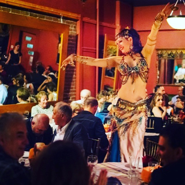 Melinda Melina Pavlata belly dancing at Karoun Restaurant's closing festivities. Photo by Bruce Mount.