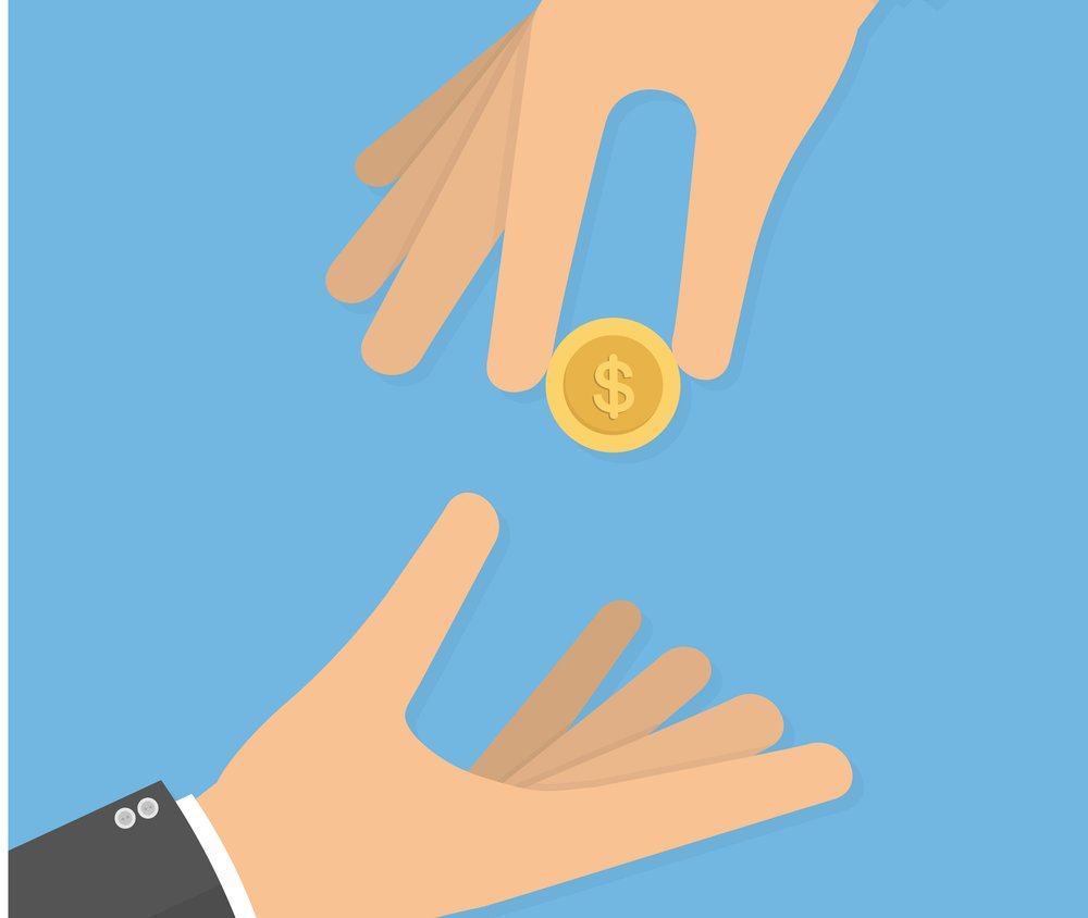 hand dropping coin into another hand graphic