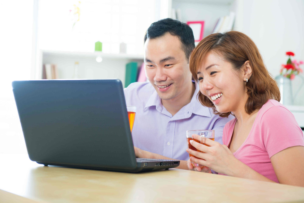 Couple using a mortgage calculator