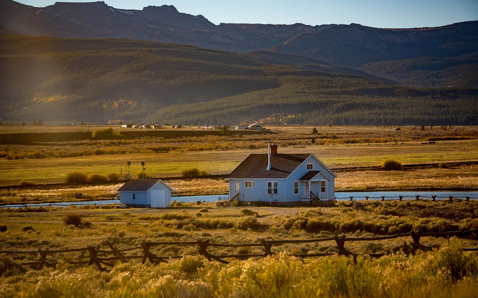 rural-house-mountains-background.jpg