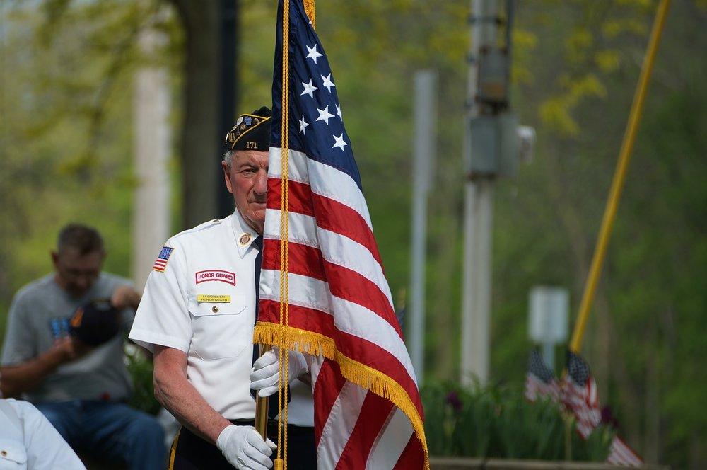 veteran holding up an american flag