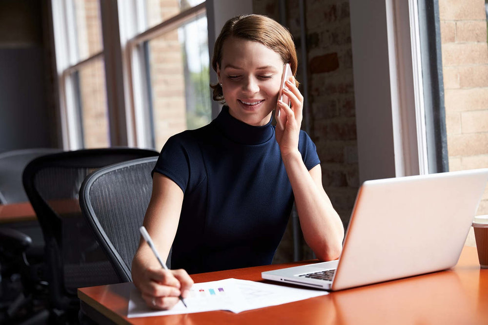 young-white-female-professional-home-office-phone.jpg
