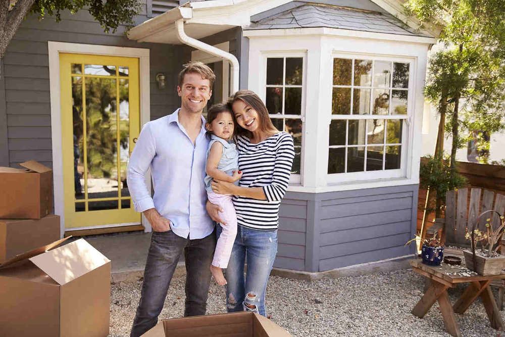mixed-race-family-young-smiling-outside-homeowners.jpg