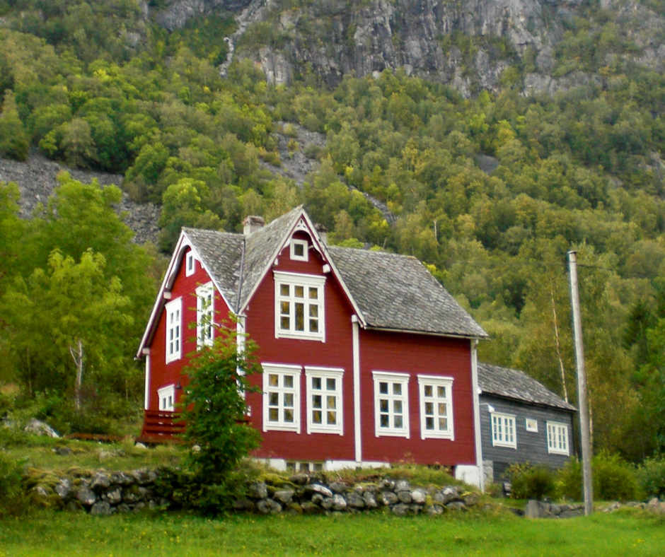 red house by mountains