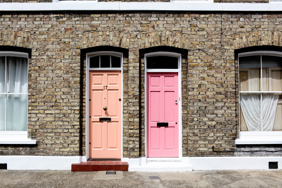 peach and pink door to brown houses