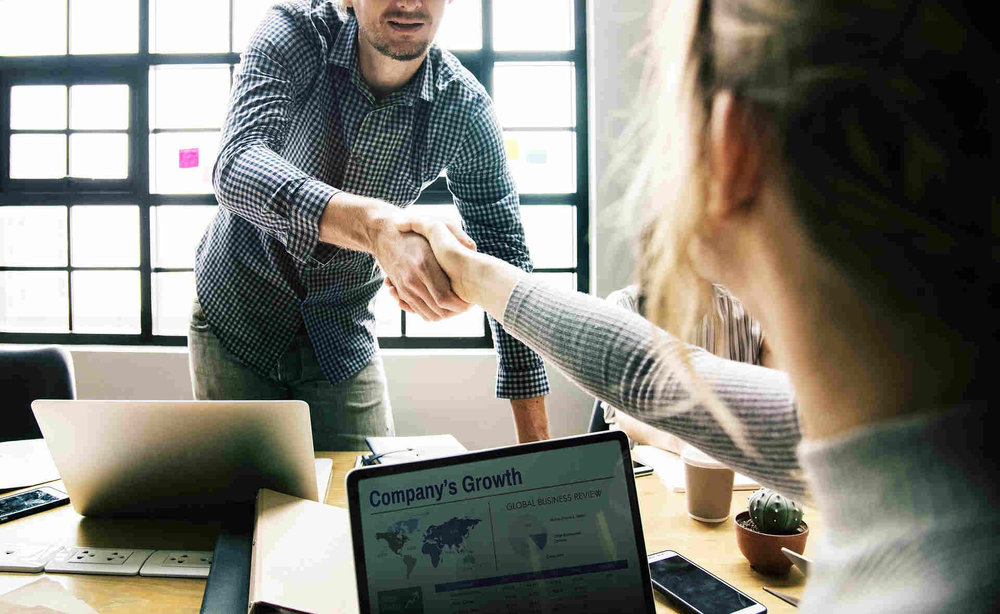 handshake on agreement with company growth on laptop (1).jpg