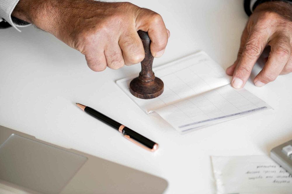 man stamping a document.jpeg