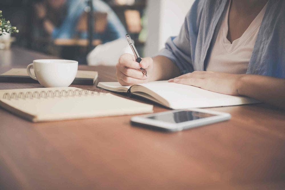 woman writing notes.jpeg
