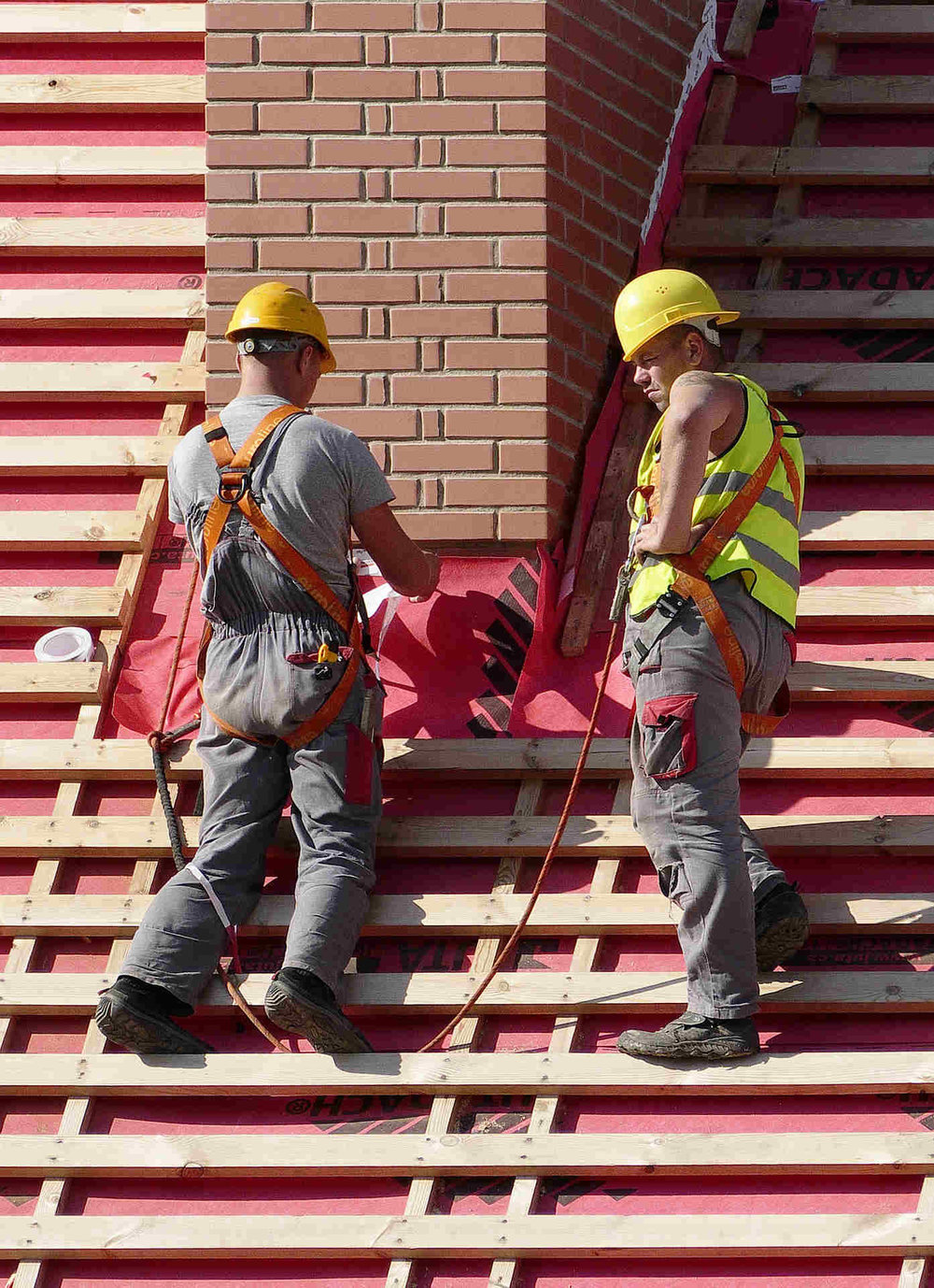 two construction men building roof.jpg