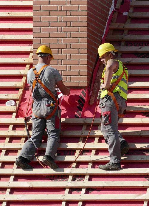 Two Construction Men Building Roof Jpg