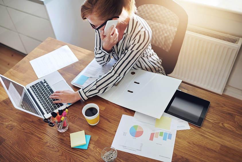 business-woman-desk-phone-computer-coffee.jpg