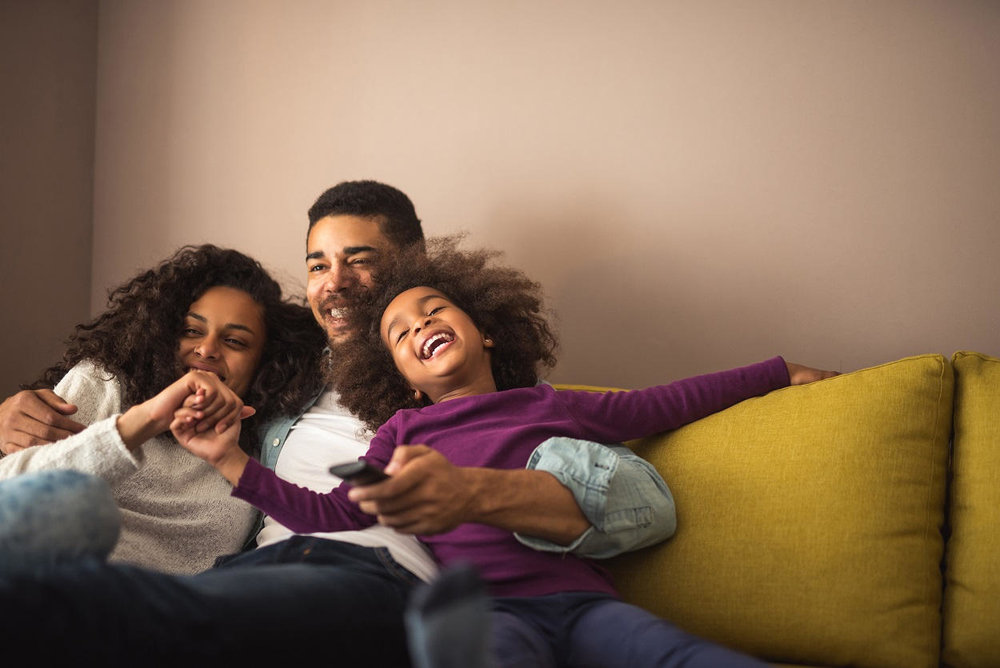 young-black-family-relaxing-in-home.jpg