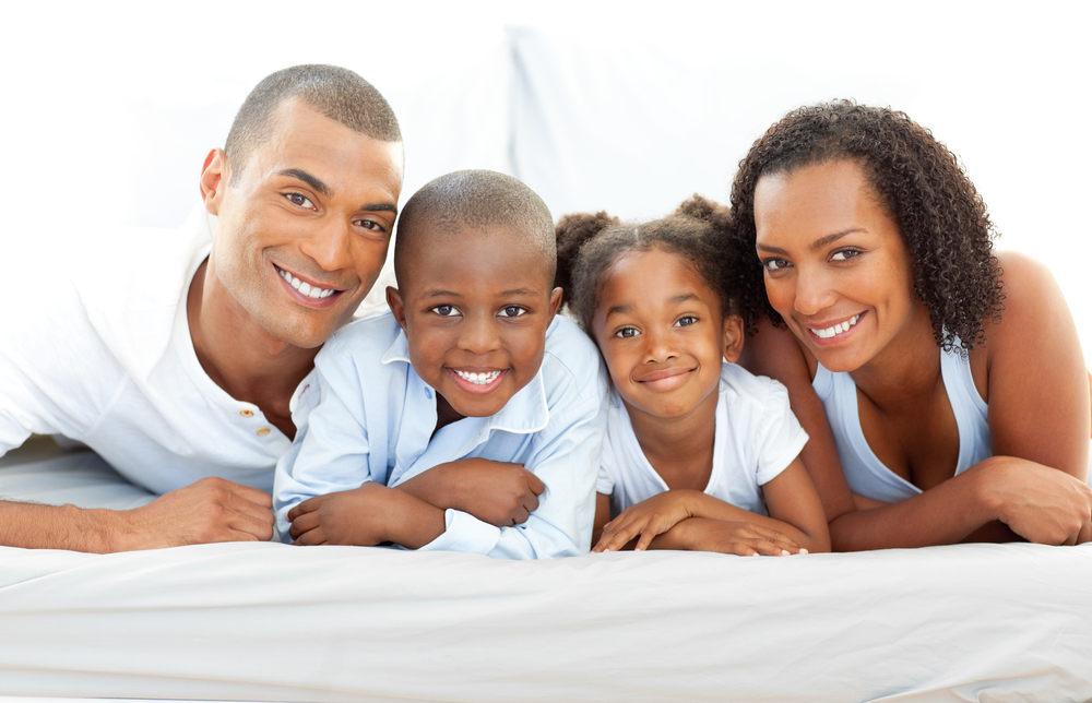 african american smiling in white.jpg
