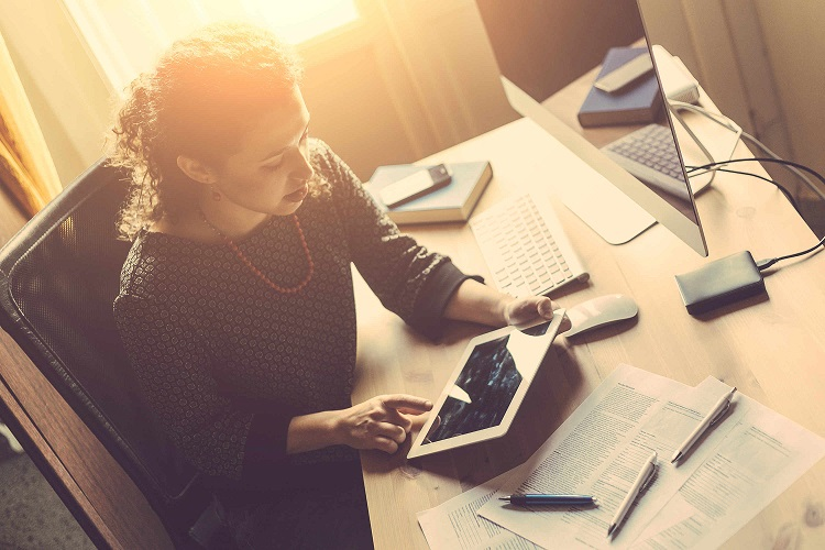 business-woman-home-office-paperwork-working.jpg