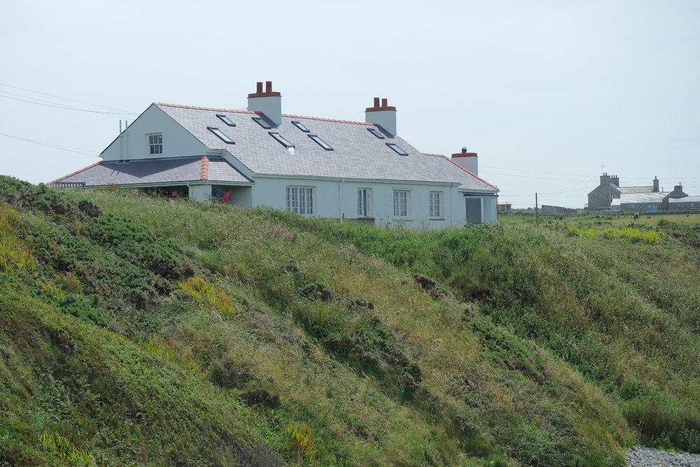 A view of the lovey cottage from the beach