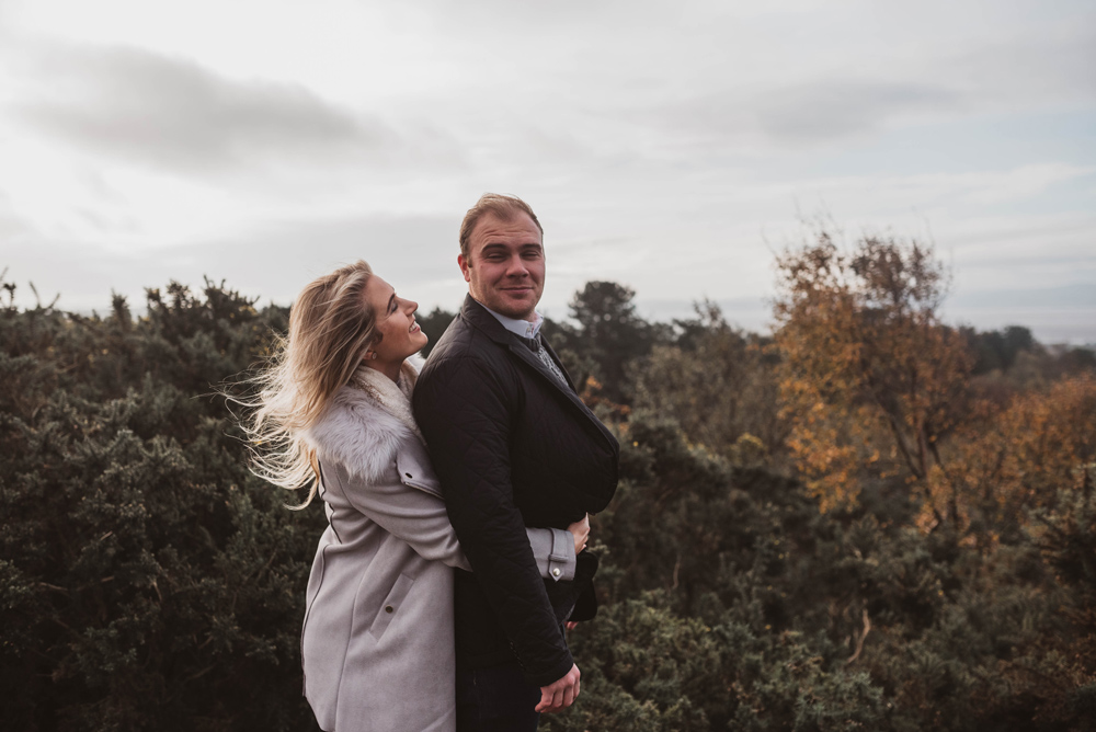 Hugging on the hill, engagement shoot