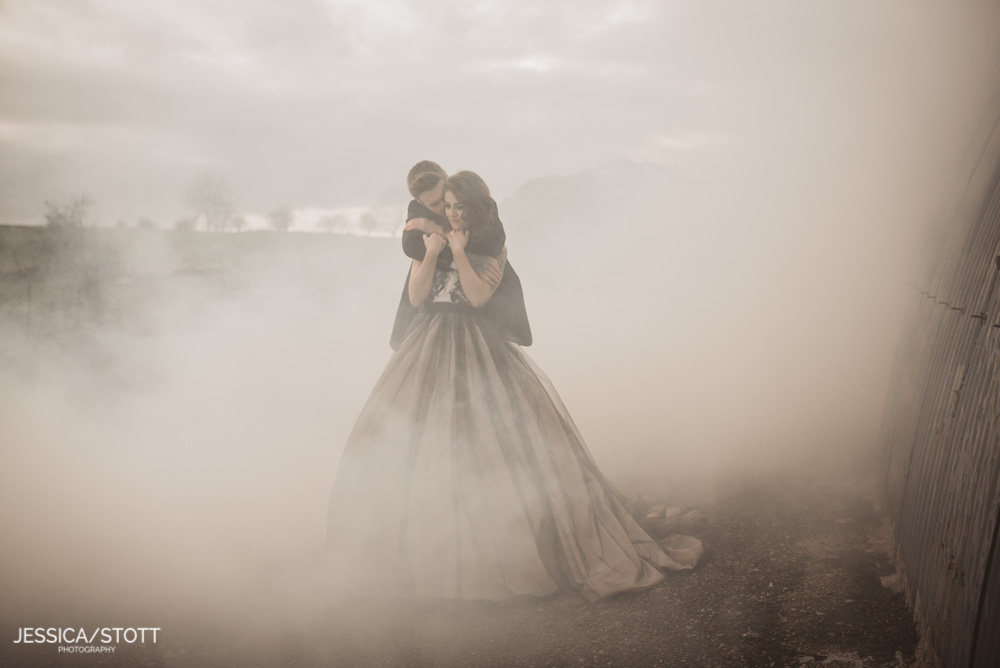 bride and groom hugging in the mist