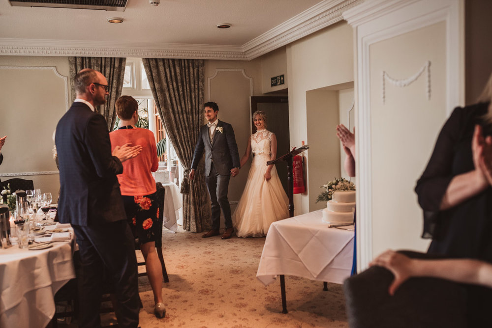 bride and groom entering room