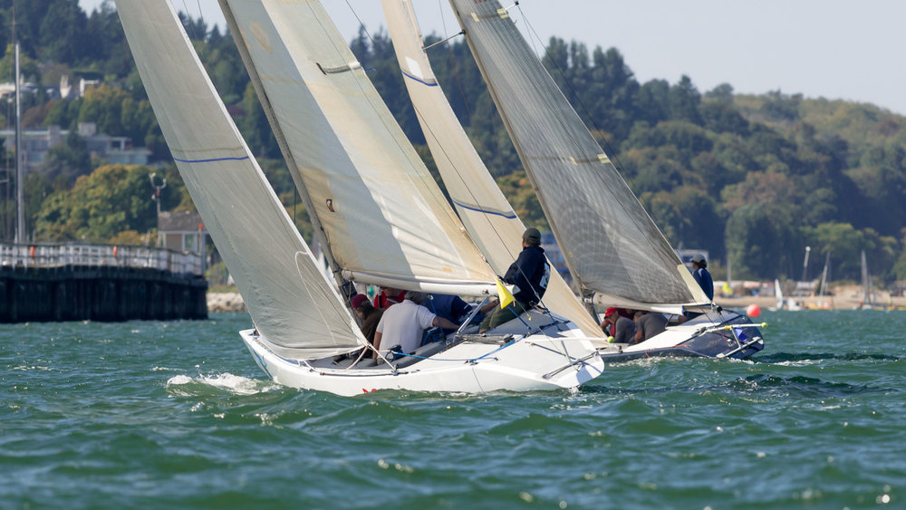 6 Metre sailboats heading upwind