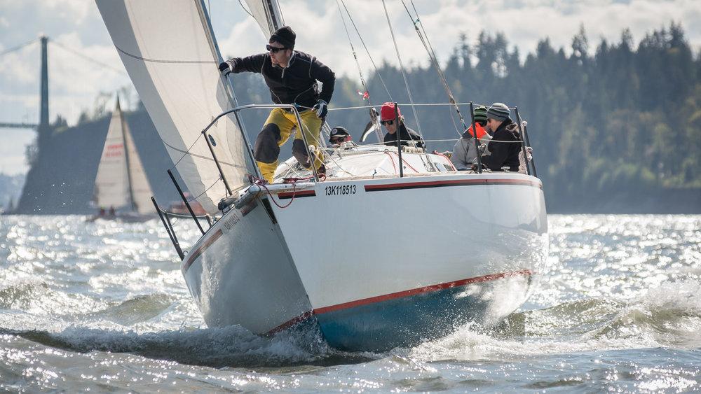 Bowman on port tack boat
