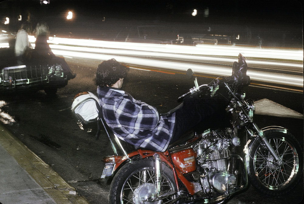 Guy reclining on his motorcycle