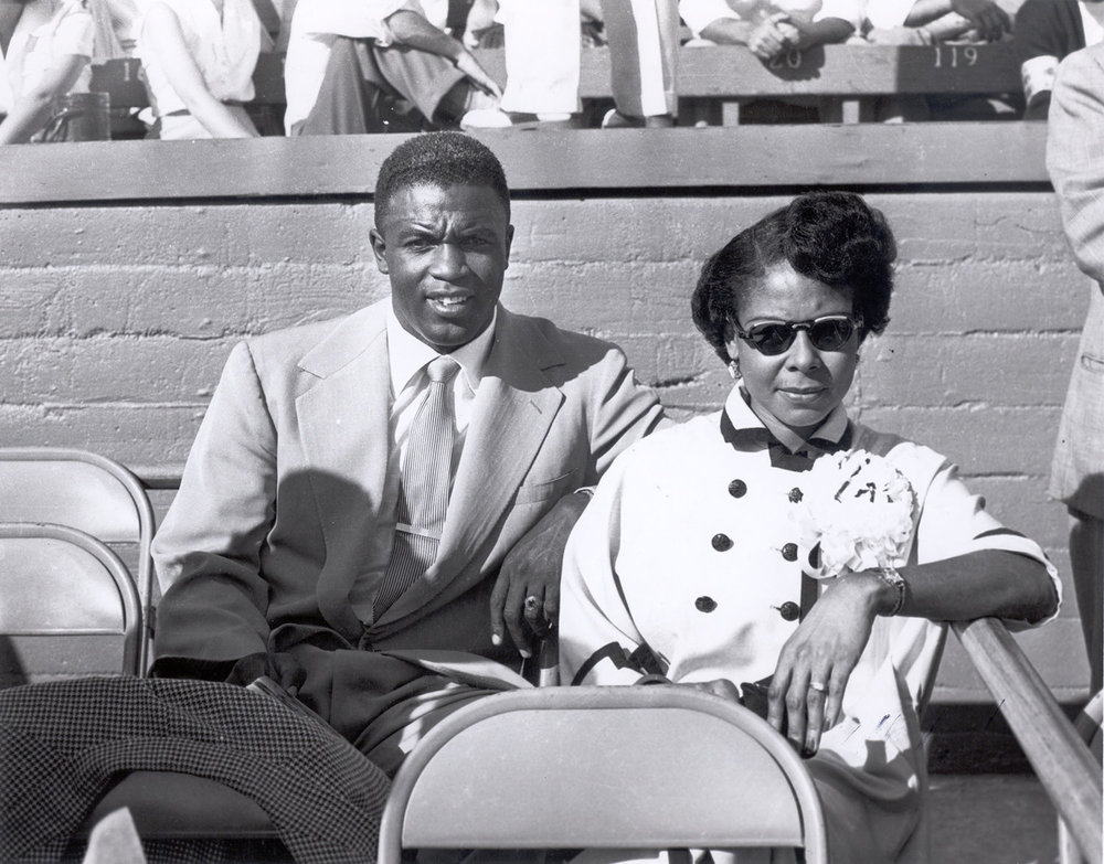 With his wife, Rachel Robinson.