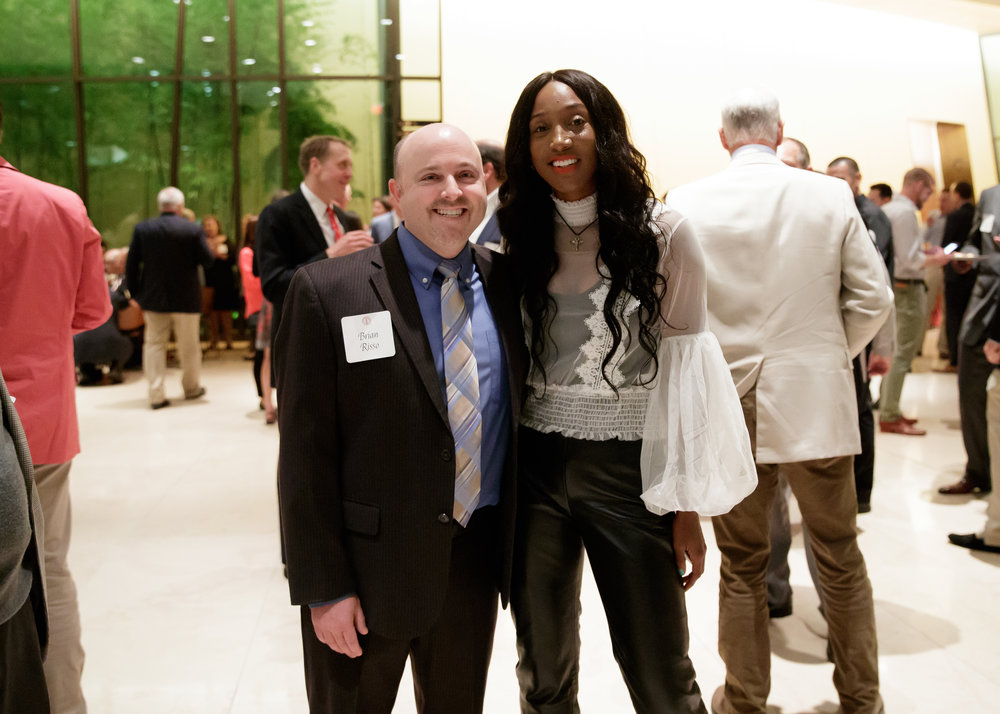 With Brian Risso. My senior year (2007-2008) Brian was the director of communications for women's basketball, and he personally organized and saved my life. Here we are seen at the reception to my induction. Grateful for you Brian!