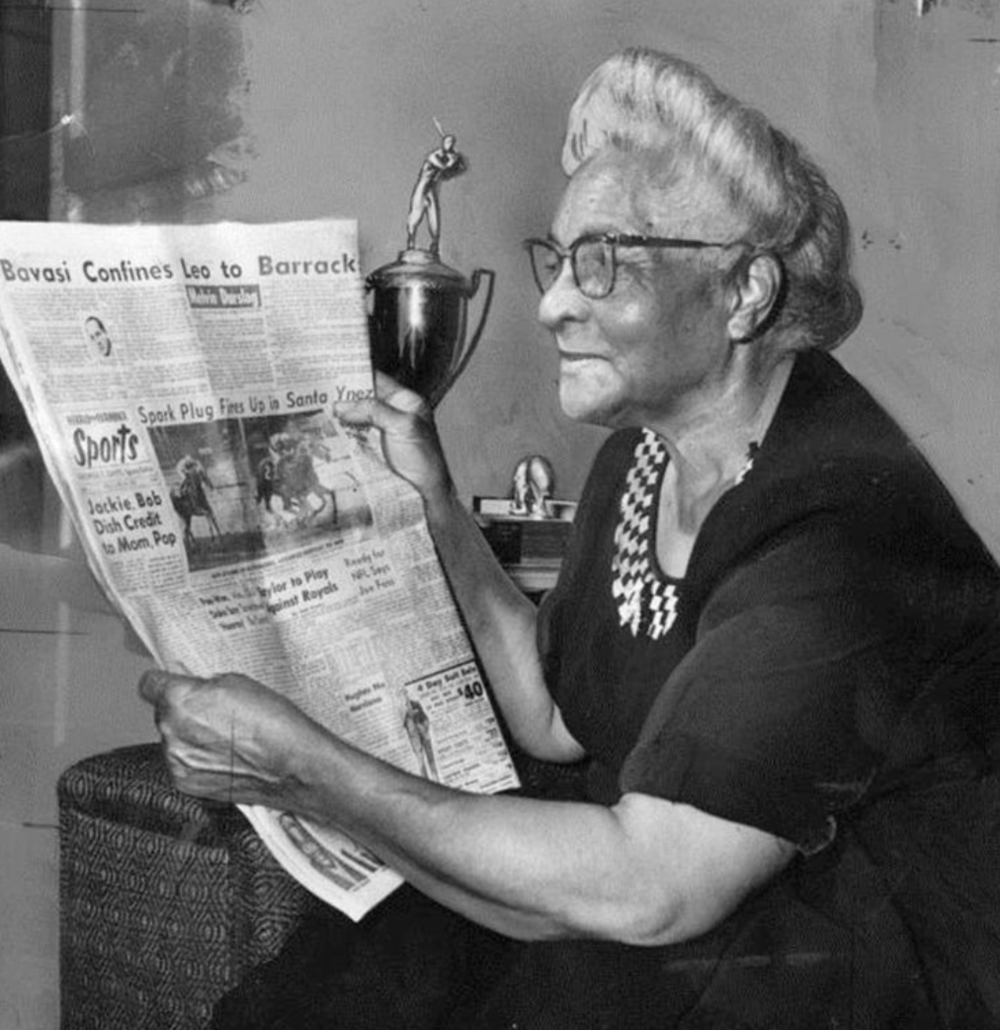 Jackie's mother Mallie reading the newspaper featuring the article on the Hall of Fame induction of her son