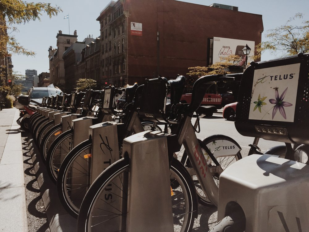 Bixi bikes on McGill Avenue via Lora Weaver Mysteries by Katy Leen