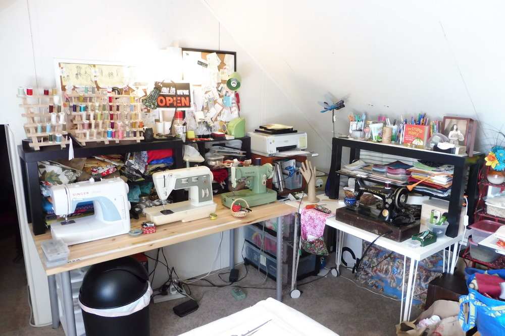 A small snapshot of my sewing studio, minus my craft shelves, drafting table, and many bins of fabric. More on those ahead!