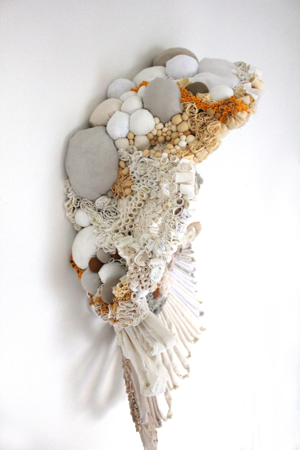 "Rugosa, 2011   reclaimed fabric, wire, glue, ink   21""L x 33""H x 12""D"