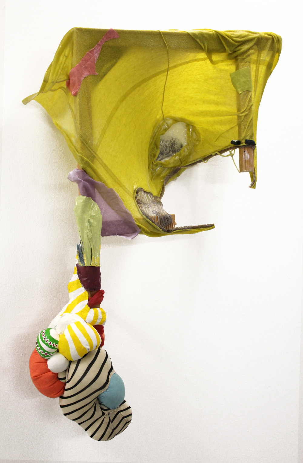"Latched On, 2014     33"" x 42""    Discarded clothing, pillows, wood, rubber, acrylic paint, paper clay"