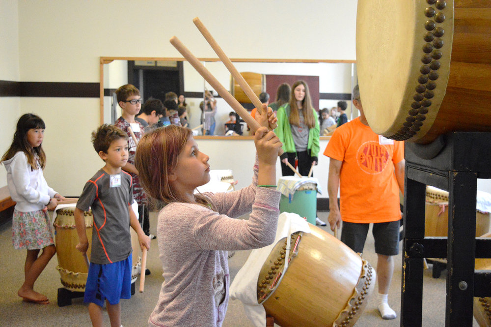 Summer campers were excited to learn taiko – traditional Japanese drumming. (Photo by Catherine Dodd)
