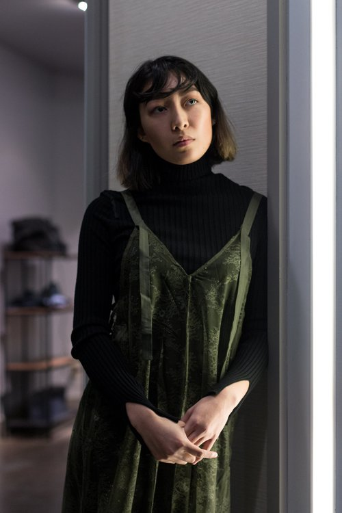 33acc7d07df Everyone looks great in a long-sleeved black turtleneck. The cheeky green  lace overlay adds a flare to this layered look. The layering of the black  under ...