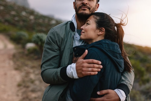 man and woman embracing enjoying life after resolving trauma