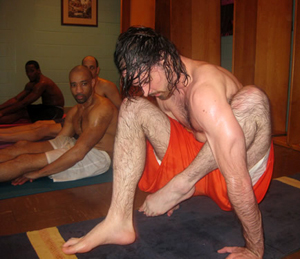 "Front to back: Colin McClees ""lifting up"" after Marichyasana, A. Jason Greene, Phillip Grayson, Faheem Marzuq"